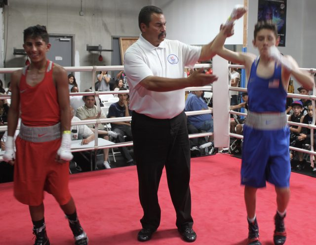 Up goes the arm of the victorious Fernando Diaz.