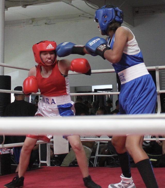 In Bout #13, Gabriela Fundora (blue trunks) did not allow her opponent to