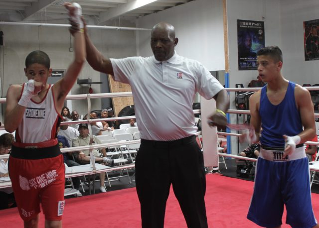 At the conclusion of Bout #14, we see Carlos Sanchez having his arm raised in victory after he defeated Andrew Sandoval.
