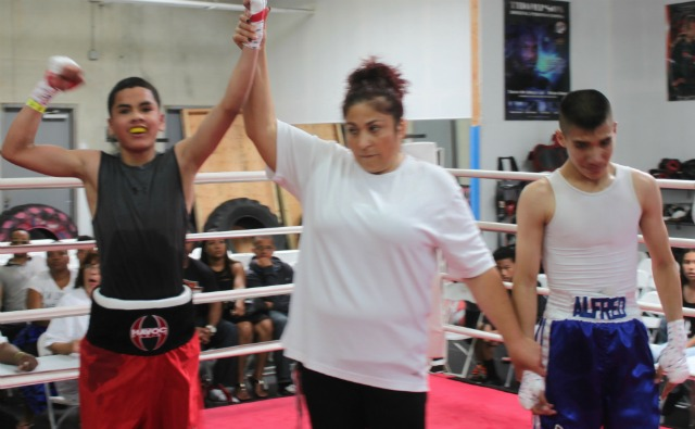 At the conclusion of Bout #6, the referee raises the arm of the victorious Jose Silva Ayala representing Nevada's LBC 49.