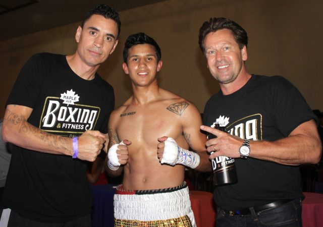 Hector Valdez's trainer Vince Parra and Manager Arnie Verbeek join the victorious Hector Valdez after his KO victory over Horacio Perez. Photos: Jim Wyatt