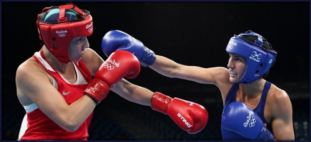 Anastasiia Beliakova of Russia fights Mikaela Mayer in the women's lightweight 60 kg. boxing competition at Riocentro on Aug. 15, 2016 in Rio de Janeiro.
