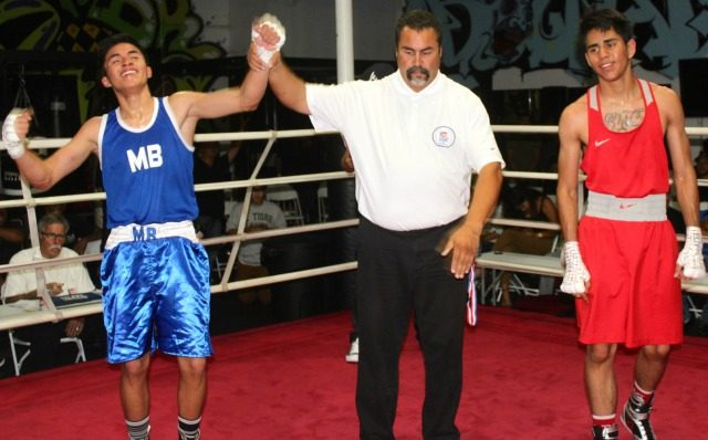 At the conclusion of Bout #13 we referee Hondo Fontane raising the arm of the victorious