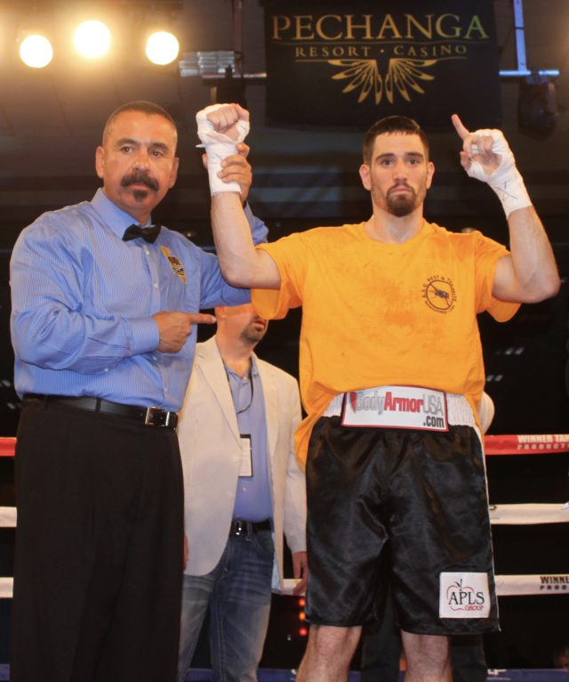 At the conclusion of the fight, referee Ray Corona raises the arm of the victorious Skender Halili.