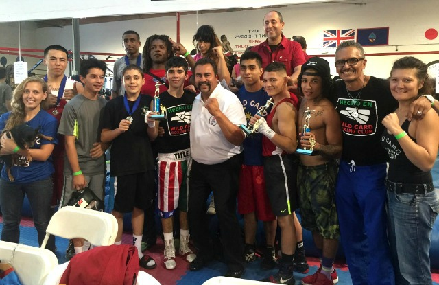 USA Amateur Boxing's LBC 44 president Hondo Fontane joins the Wild Card Boxing team as they proudly display their winning trophies.
