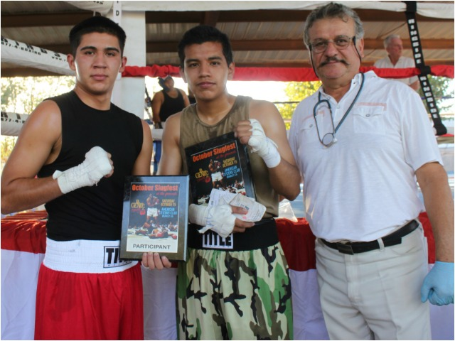 After stopping to se the fight doctor, the combatants in Bout #6, the winner Johnathan Gaspar and his opponent Julio Avila pose for one last phot with the fight doctor Arturo Garcia.