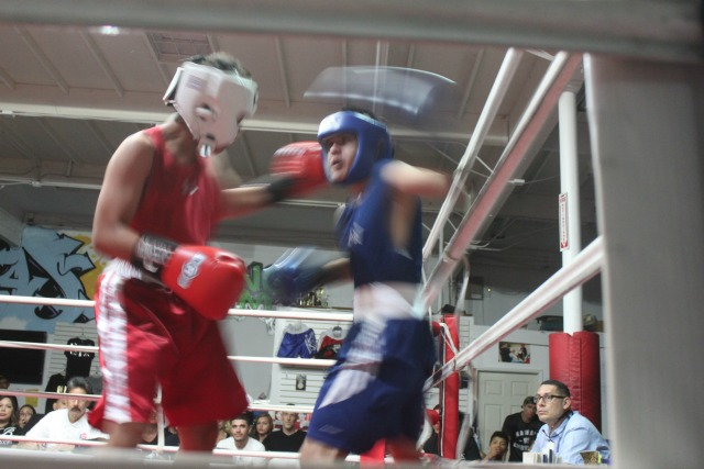In Bout #1, it was a matter of quickness and in this photo it's clear to see that Mario Salas' punches were getting to their target before (l)
