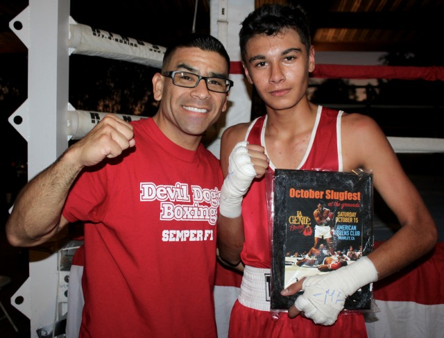 After his big win, Damien Vargas poses for a photo with his devoted coach, Valenzuela.