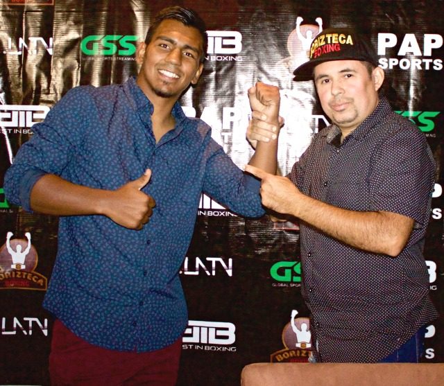 One of the headliners, Silva poses for a photo with Saul Rios, the CEO of the Borizteca Boxing Management Group.